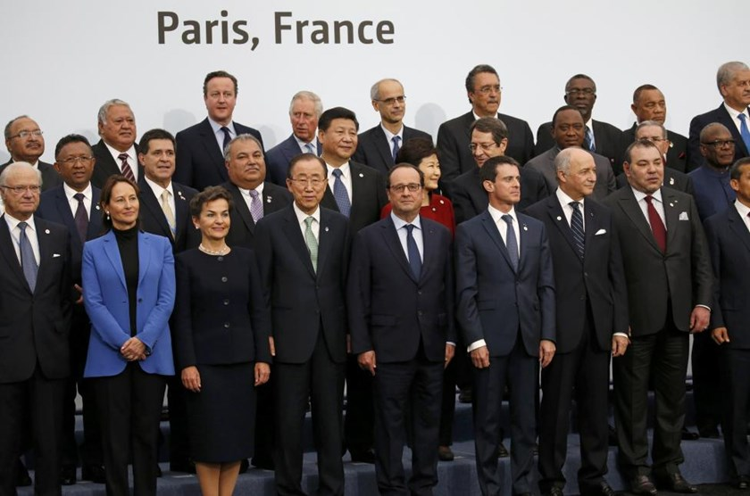 French President Francois Hollande (C, 1st row), United Nations Secretary General Ban Ki-moon (4th, 1st row) and Christiana Figueres (3rdL, 1st row), Executive Secretary of the UN Framework Convention on Climate Change, pose for a family photo with head of states and government during the opening day of the World Climate Change Conference 2015 (COP21) in Le Bourget, near Paris, France, November 30, 2015.