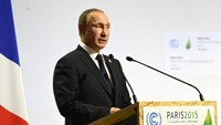 Russian President Vladimir Putin delivers a speech during the opening day of the World Climate Change Conference 2015 on November 30, 2015