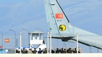 The coffin of the pilot killed when Turkey shot down a Russian jet is carried to a Turkish Air Force Cargo Aircraft, before being handed over to Russia, on the tarmac of the Hatay Airport in Hatay, Turkey, November 29, 2015.