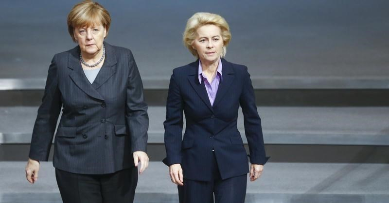 German Chancellor Angela Merkel and Defence Minister Ursula von der Leyen (R) walk during a session of the Bundestag, the German lower house of parliament, in Berlin, Germany, December 4, 2015