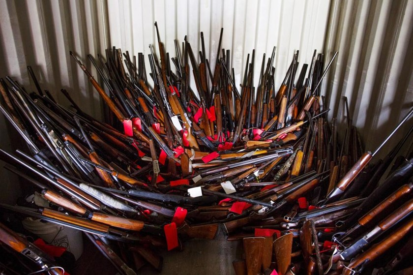 Stacks of guns belonging to Brent Nicholson, seen in a police shipping corner, in Pageland, South Carolina, November 10, 2015.