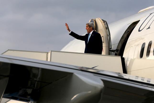 U.S. Secretary of State John Kerry boards his plane to return to Washington from Athens International Airport in Athens, Greece December 4, 2015.