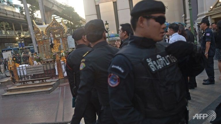 Policemen stand guard during a religious ceremony at the Erawan shrine - the popular tourist site where 20 people were killed on Aug 17 - in central Bangkok. Photo: AFP