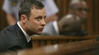 South African Olympic and Paralympic track star Oscar Pistorius listens to the verdict in his trial at the high court in Pretoria September 12, 2014