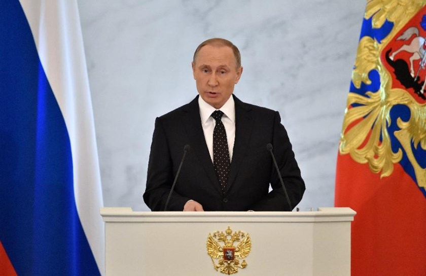 Russian President Vladimir Putin delivers his annual state of the nation address at the Kremlin in Moscow on December 3, 2015