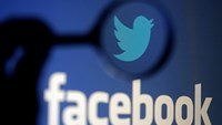 A logo of Twitter is pictured next to the logo of Facebook in this September 23, 2014 illustration photo in Sarajevo.