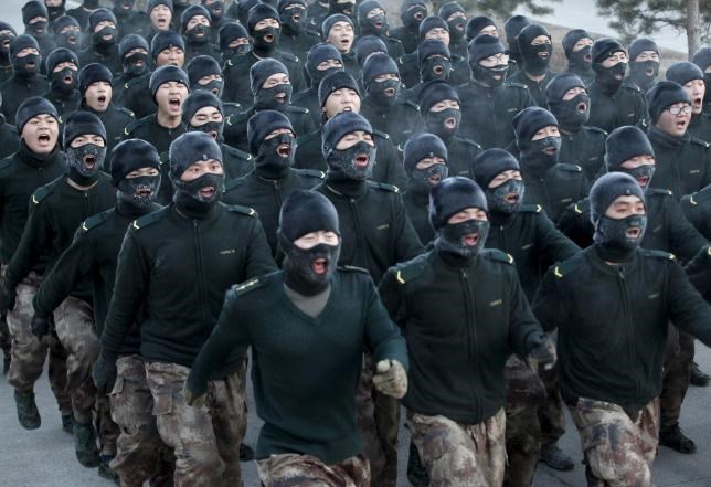 New recruit People's Liberation Army (PLA) soldiers shout slogans as they march during a training session in cold winter temperatures at a military base in Heihe, Heilongjiang province, China, November 29, 2015.