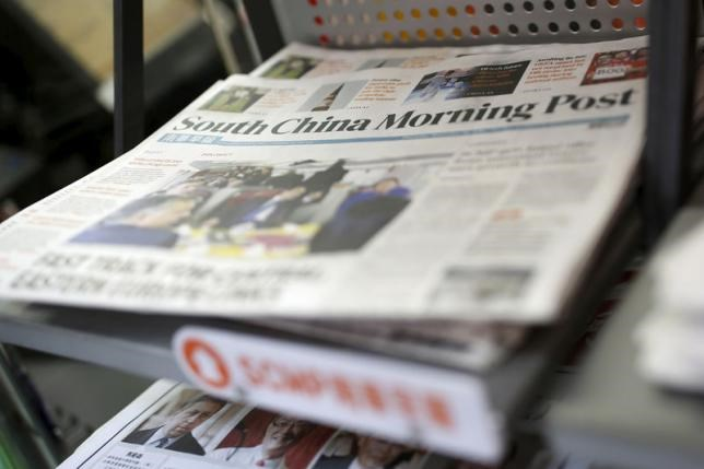 Copies of the South China Morning Post (SCMP) newspaper are seen on a newspaper stand in Hong Kong, China November 26, 2015.