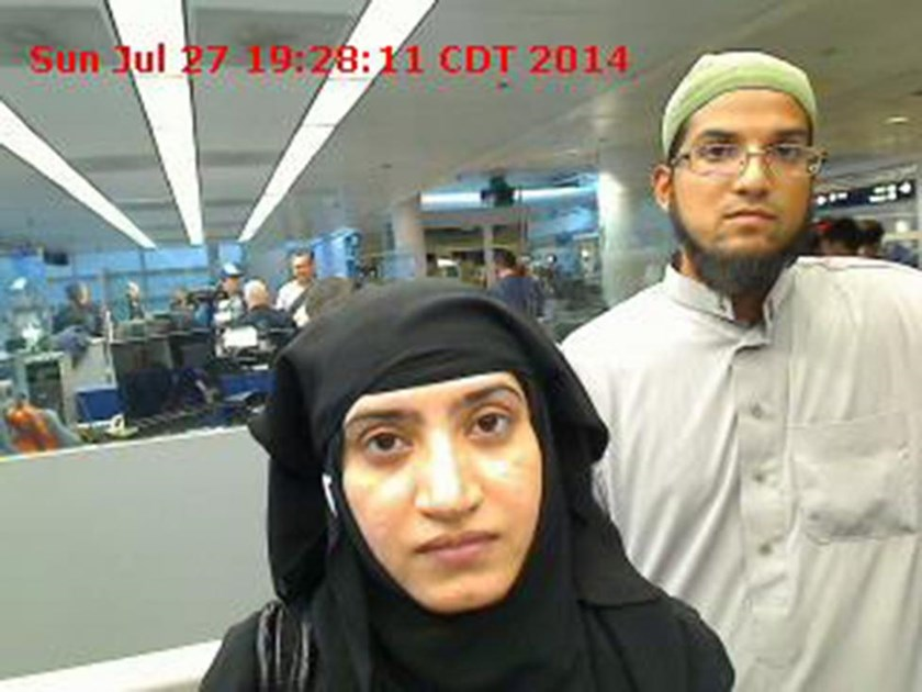Tashfeen Malik, (L), and Syed Farook are pictured passing through Chicago's O'Hare International Airport in this July 27, 2014 handout photo obtained by Reuters December 8, 2015.