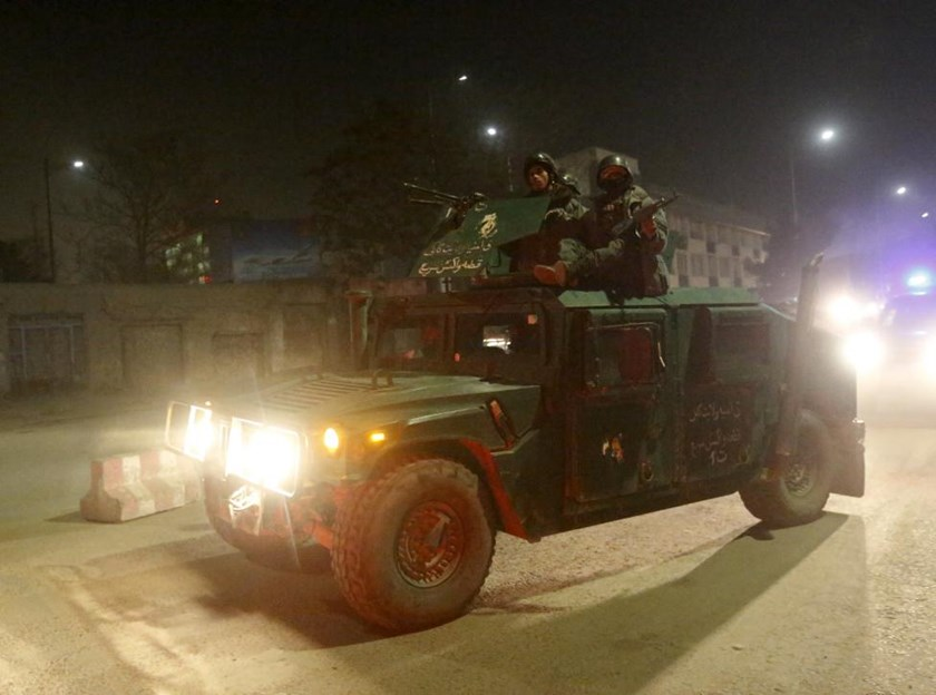 Afghan policemen arrive at the site of a Taliban attack in the Afghan capital of Kabul, Afghanistan December 11, 2015.