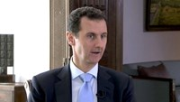 Syrian President Bashar al-Assad speaks during a TV interview in Damascus, Syria in this still image taken from a video on November 29, 2015.