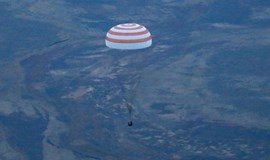 Three astronauts land back on Earth from space station