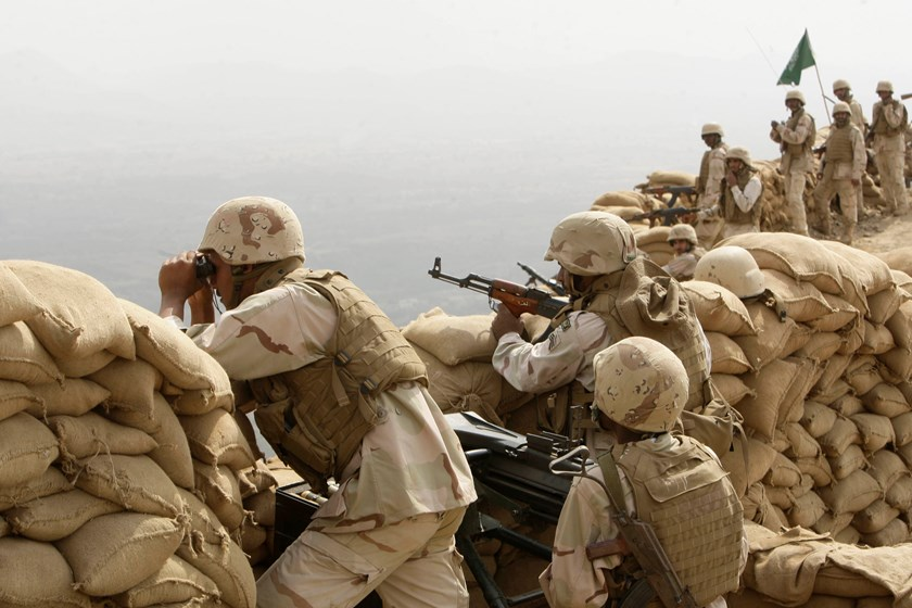 Saudi soldiers keep watch at Khoba, the frontline border with Yemen.