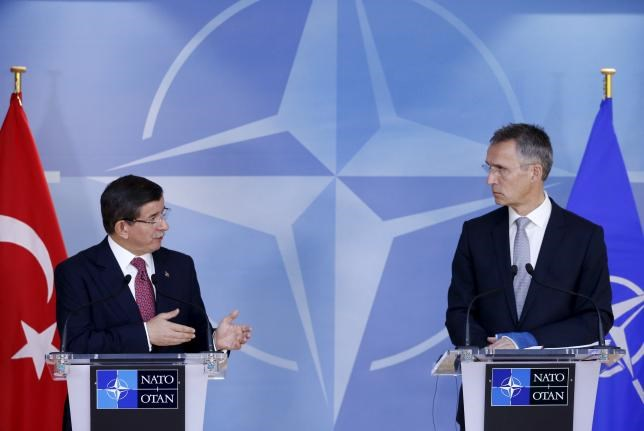 Turkish Prime Minister Ahmet Davutoglu (L) and NATO Secretary-General Jens Stoltenberg address a joint news conference at the Alliance's headquarters in Brussels, Belgium, November 30, 2015.