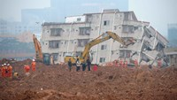 Rescuers are seen working at the site of a landslide that hit an industrial park in Shenzhen. Photo: AFP