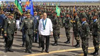 Philippines vows stronger military to back South China Sea claim