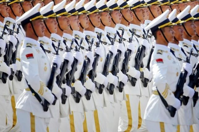 China's People's Liberation Army (PLA) navy soldiers march at Tiananmen Square during the military parade marking the 70th anniversary of the end of World War Two, in Beijing September 3, 2015.