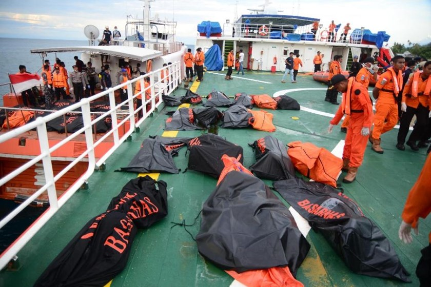 Bodies can be seen onboard a vessel during a search and rescue operation in the Sulawesi sea on December 24, 2015 after a ferry sank in the area