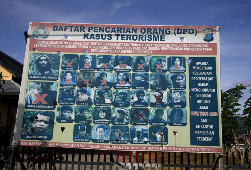 A police billboard showing a list of individuals, including the country's top militant Santoso (top L), wanted in relation with terrorism cases in Poso, Indonesia's Central Sulawesi province, December 19, 2015.