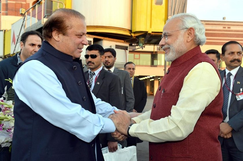 Indian Prime Minister, Narendra Modi (R) shakes hands with Pakistan Prime Minister Nawaz Sharif upon his arrival in Lahore on December 25, 2015