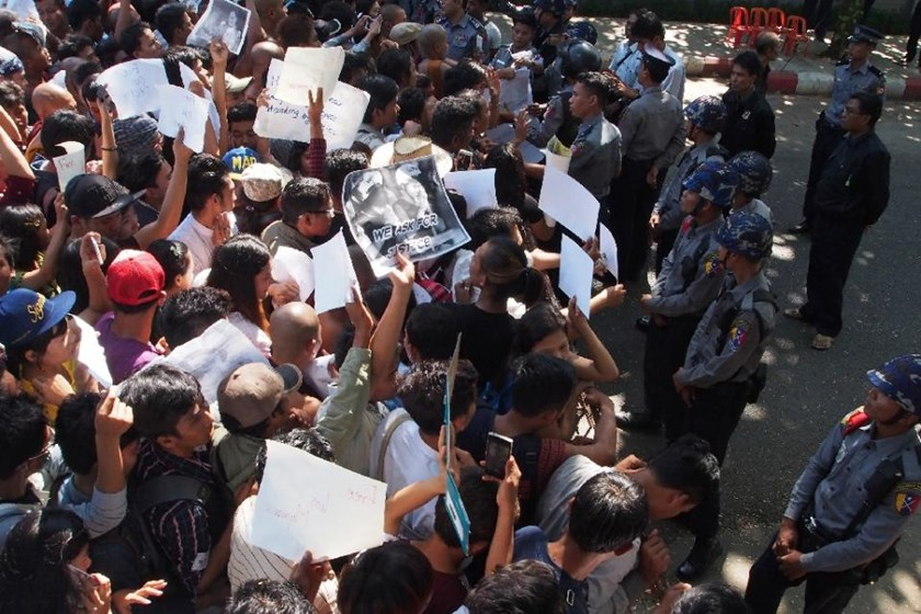 Demonstrators protest outside the Thai embassy in Yangon on December 25, 2015 against the death sentence of Myanmar workers Zaw Lin and Win Zaw Tun for the murder of two British tourists