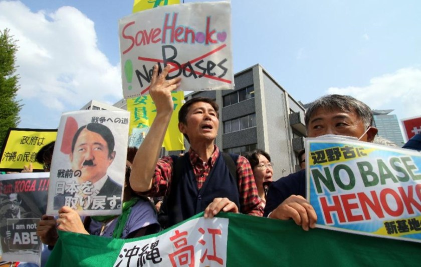 Activists shout slogans as they protest against the construction of a new US military base in Okinawa during a rally in front of the prime minister's residence in Tokyo on April 17, 2015 as Okinawa Governor Takeshi Onaga met with PM Shinzo Abe