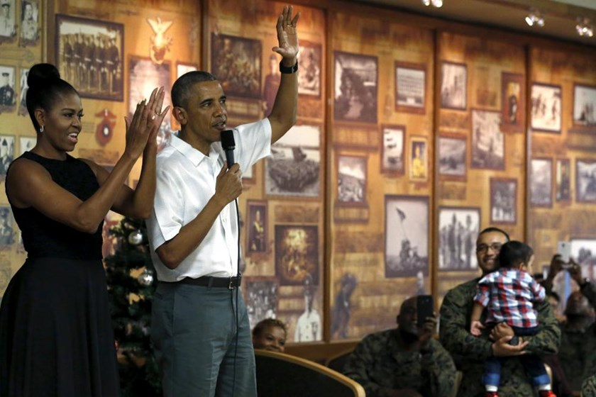 U.S. President Barack Obama, with first lady Michelle Obama, delivers remarks at a Christmas reception with service members at Marine Corps Base Hawaii in Kaneohe Bay, Hawaii December 25, 2015.