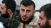 Zahran Alloush (C), commander of Jaysh al Islam, talks during a conference in the town of Douma, eastern Ghouta in Damascus, Syria August 27, 2014.