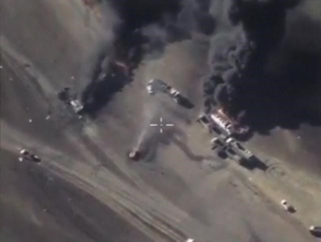 A frame grab taken from footage released by Russia's Defence Ministry December 25, 2015, shows air strikes carried out by Russia's air force hitting militants' vehicles, which, according to the ministry, carried oil, at an unknown location in Syria.