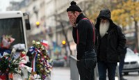 Eagles of Death Metal bandmates Jesse Hughes (L) and Dave Catching returned to the Bataclan concert hall on December 8 2015 to mourn those who died in the November 13 jihadist attacks across Paris