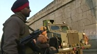 Police personnel stand guard following what officials said was an attack on an Indian Air Force base in Pathankot on Saturday near the border with Pakistan, in Pathankot, Punjab state, India, in this still frame taken from video, January 2, 2016.