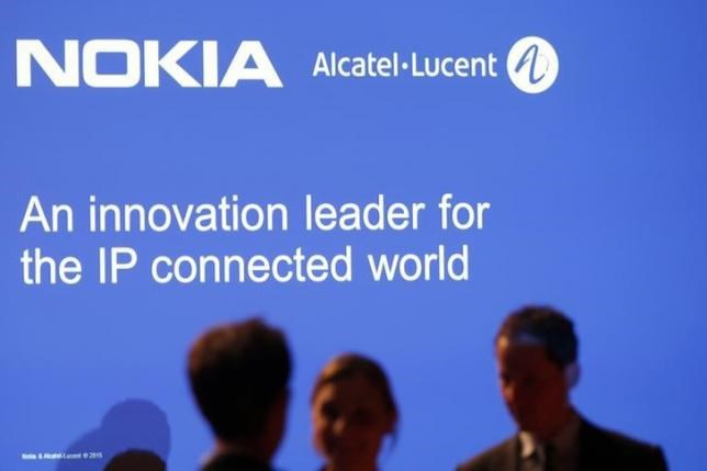 Media people attend a news conference with Nokia and Alcatel-Lucent in Paris April 15, 2015.