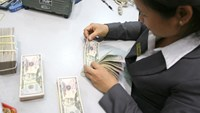 Vietnam weakens dong fixing as it adopts market-based rate