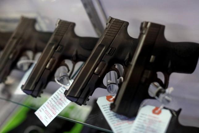 Handguns are seen for sale in a display case at Metro Shooting Supplies in Bridgeton, Missouri, November 13, 2014.