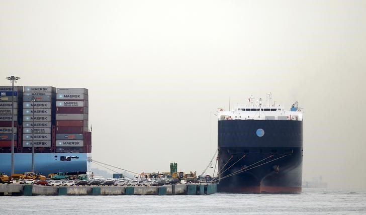 A container ship (L) and a car carrier dock at Singapore port November 2, 2015.