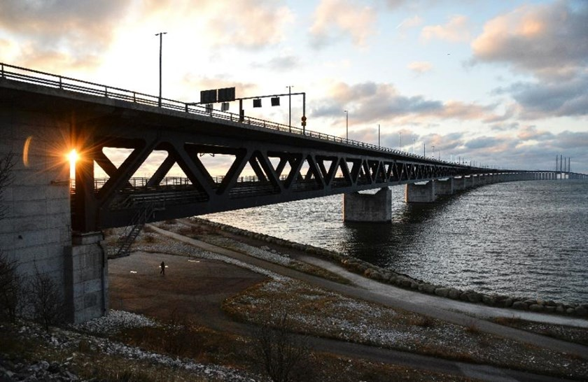 The sun sets over the Oresund Bridge between Sweden and Denmark, in Malmo, Sweden, on January 3, 2016