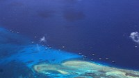 Chinese fishing vessels are seen anchored at Fiery Cross reef on the disputed Spratly islands in the South China Sea
