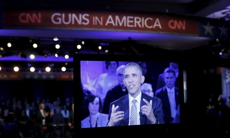 U.S. President Barack Obama is seen on a monitor as he speaks during a live town hall event on reducing gun violence hosted by CNN's Anderson Cooper at George Mason University in Fairfax, Virginia January 7, 2016.
