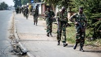 Burundian soldiers withdrawing from the restive Cibitoke neighbourhood in Bujumbura after a police operation during the celebrations of the country's 53rd Independence Anniversary on July 1, 2015
