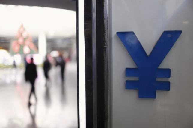 A logo of yuan is seen at a foreign exchange store in Shanghai, China, December 1, 2015.