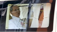 Thailand's King Bhumibol Adulyadej sits in a vehicle as he leaves Siriraj Hospital for the Grand Palace to join a ceremony marking Coronation Day in Bangkok, Thailand, May 5, 2015.