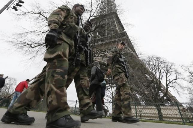 French soldiers patrol near the Eiffel Tower in Paris as part of the ''Vigipirate'' security plan December 23, 2014.