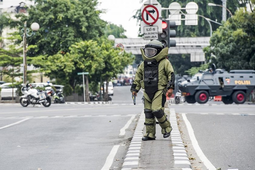 A member of the police bomb squad unit approaches the scene of an explosion following an attack on a police box in central Jakarta January 14, 2016 in this photo taken by Antara Foto.