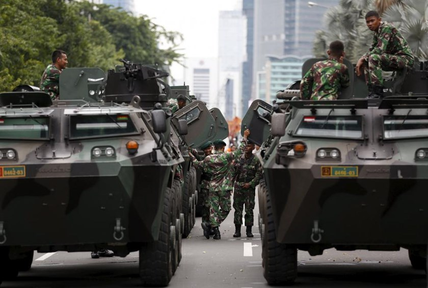 Military armoured personnel carriers are seen near the site of an attack in central Jakarta January 14, 2016.