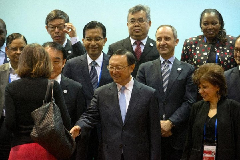 Chinese State Councilor Yang Jiechi (C) greets attendees while posing for a group photo at a meeting of G20 representatives in Beijing, on January 14, 2016