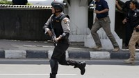 An Indonesian policeman runs near the site of a blast in Jakarta, Indonesia, January 14, 2016.