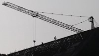 Labourers work on top of a construction site in Jinning, Yunnan province, China, October 20, 2015.