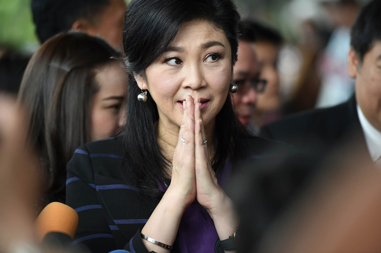 Thailand's Yingluck appears in court for start of criminal trial