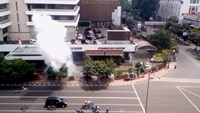 Smoke rises after a bomb exploded outside a Starbucks shop in Jakarta, Indonesia in this still image taken from amateur video shot on January 14, 2016.