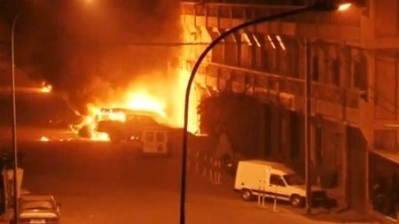 A view shows vehicles on fire outside Splendid Hotel in Ouagadougou, Burkina Faso in this still image taken from a video January 15, 2016, during a siege by Islamist gunmen.